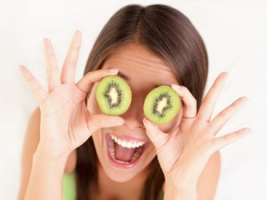 woman with kiwi fruit eyes photo